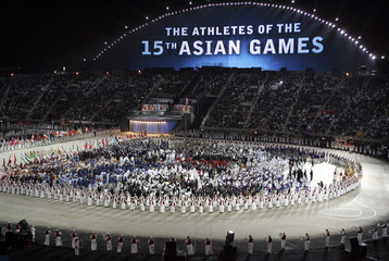 A general view of the opening ceremony of the 15th Asian Games is seen at Khalifa Stadium in Doha December