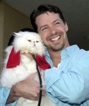 "Actor Sean Hayes, a cast member in the motion picture ""Cats & Dogs"" poses June 23, 2001 with Mr. Tin.."