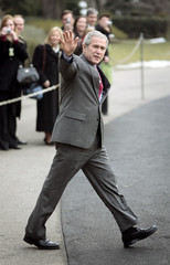 U.S. President Bush waves as he walks from the White House to Marine One in Washington