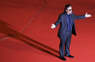 """U.S. actor and director Al Pacino gestures on the red carpet as he arrives for his movie """"Chinese Coffee"""" at Rome's Film Festival"""