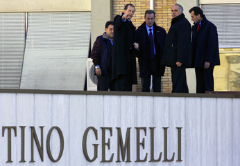 Vatican television and radio technicians check a roof at Gemelli hospital where Pope John Paul II is ...