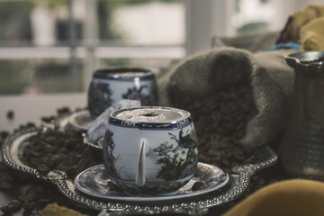 Turkish Coffee cup and saucer on a wooden table
