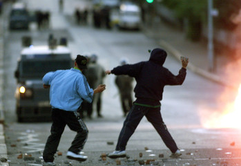 NATIONALIST YOUTH ATTACK POLICE DURING RIOTS IN NORTH BELFAST.
