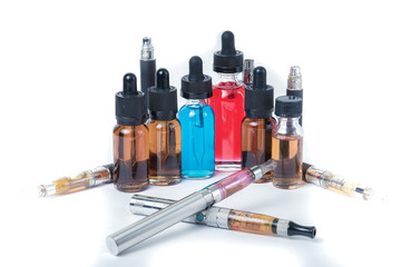 4 electronic cigarettes with glass e-liquid bottles and batteries on white background