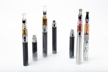 Electronic cigarettes with smoke on white background