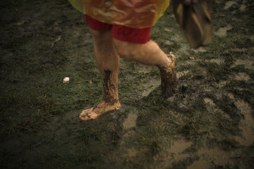 Fan walks through mud during All Points West music festival in New Jersey
