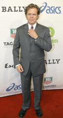 Actor William H. Macy poses for photographers during red carpet arrivals at the Oxfam annual fundraiser in Beverly Hills