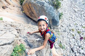 Smiling baby Girl in protective Rock climbing Helmet Portrait