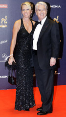 German anchor Elstner is accompanied by Gessler at the 60th Bambi media awards ceremony in the southwestern German town of Offenburg