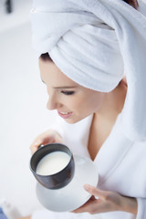 Young woman having a morning milk