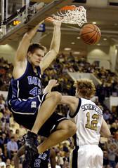 DUKE PLAYER RANDOLPH DUNKS THE BALL OVER TECH'S SCHENSCHER IN ATLANTA.
