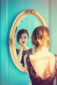 young woman looking at mirror