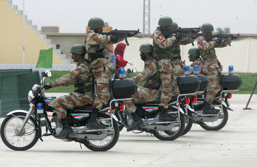 An anti-terrorism squad from the Pakistan Rangers perform their skill during their passing out ...