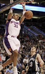 Phoenix Suns Shawn Marion scores against Memphis Grizzlies Mike Miller in Phoenix.