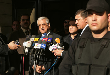 Palestinian President Mahmoud Abbas talks to the media outside his headquarters in Gaza