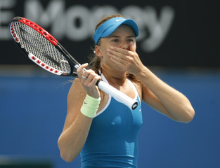 Slovakia's Hantuchova puts her hand over her mouth during her match against France's Johansson at the Australian Open tennis tournament in Melbourne