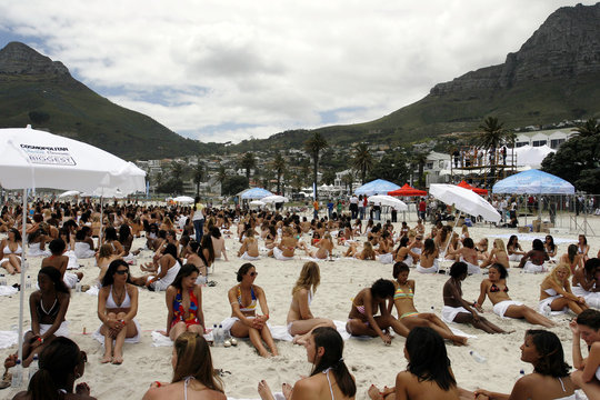 Some of the 530 bikini girls pose for a picture during an attempt to set a new world record for the most bikini-clad people in one photo shoot at the Camps Bay beach