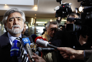 Portugal's Foreign Minister Luis Amado answers reporters' questions in Brussels