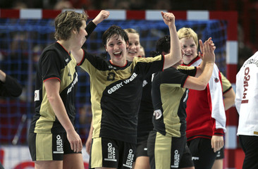 Germany's Jurack and  Muller react after defeating Angola during their women's world handball championship quarter-final match at Bercy in Paris