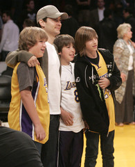Actor Maguire poses for a photograph with some fans after NBA basketball game between the Cleveland Cavaliers and the Los Angeles Lakers at the Staples Center in Los Angeles