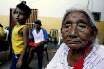 An elderly Guatemalan woman rests before leaving Bolivia from Santa Cruz