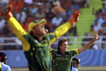 Australia's wicketkeeper Gilchrist and McGrath celebrate the dismissal of India's Tendulkar in Mohali