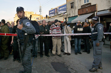 Israeli police officers stand guard at the scene of a suicide bombing in Tel Aviv