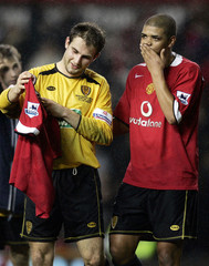 Burton Albion's Anderson and Webster leave pitch after their FA Cup match against Manchester United in Manchester