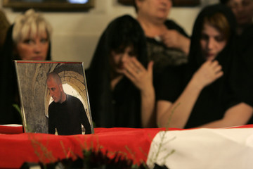 Relatives of Major Dolidze who killed in the South Ossetia conflict, mourn during a funeral ceremony in Tbilisi