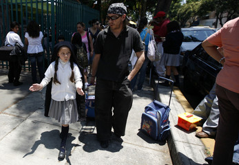Claudio Vargas, 40, also known as Anxelica Risco, walks with his daughter Shadra after school in Mexico City
