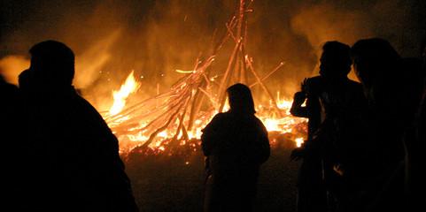 Iranian Zoroastrians stand around bonfire during celebration to commemorate Sade in Tehran.