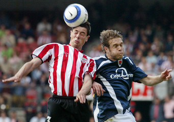 Athletic Bilbaos del Horno and Numancias Tevenet jump for ball during their match in Bilbao.