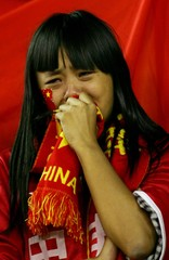 Supporter for China national team weeps in Guangzhou.