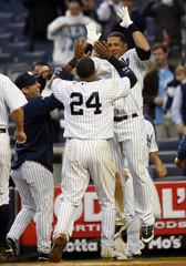 Yankees' Cabrera and Cano celebrate game winning home run against Athletics in New York