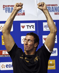 Bousquet of France reacts on the podium after winning the men's 100m freestyle swimming final event at the French Swimming Championships in Montpellier