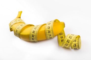 size matters concept, banana with measuring tape
