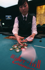 A card dealer deals a hand for a poker at the Paradise Walker-hill casino in Seoul