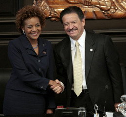 Canada's Governor General Michaelle Jean shakes hands with the President of Mexico's Senate Carlos Navarrete  before her speech at the Senate building in Mexico City