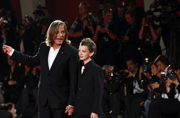 U.S. actor Mortensen and Australian actor Smit-McPhee arrive at the red carpet during at the 66th Venice Film Festival