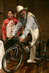 Man dressed up as Colombia's coffee icon Juan Valdez poses for the media during the launch of the 'Cafe de Colombia' cycling team in Bogota