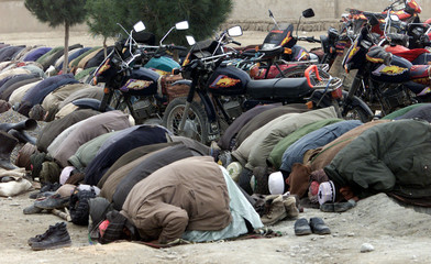 Afghan men attend Friday prayers in Khoja Bahawuddin, a stronghold of the Northern Alliance November..