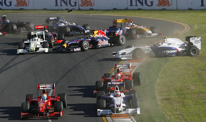 Formula One cars spin and slide after an accident on the first corner of the first lap of the Australian F1 Grand Prix in Melbourne