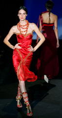 A model presents a creations as part of Valentin Yudashkin Spring/Summer 2005 women's collection dur..