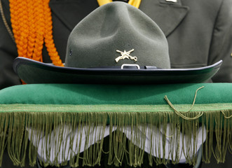 A Colombian police officer carries the hat of policeman Jimmy Tellez at a police base in Bogota