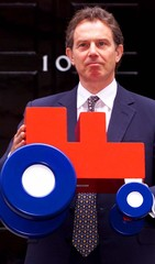 TONY BLAIR HOLDS A MODEL OF THE NEW NFU LOGO IN DOWNING STREET.