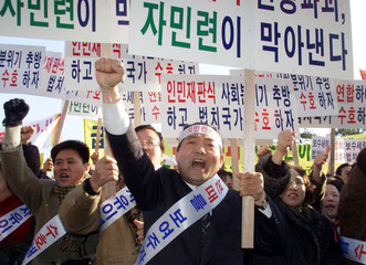 SOUTH KOREAN MEMBERS OF THE UNITED LIBERAL DEMOCRATS PARTY SHOUT SLOGANS IN SEOUL.