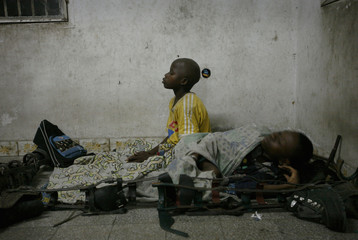 A boy afflicted by polio prays before going to sleep on the floor inside the International Polio Victim Response Committee compound in Congo's capital Kinshasa