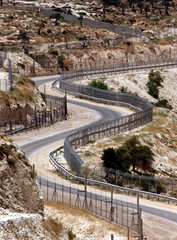 GENERAL VIEW SHOWS THE ELECTRIC SECURITY FENCE BEING CONSTRUCTED TOSEPARATE BETHLEHEM FROM JERUSALEM.