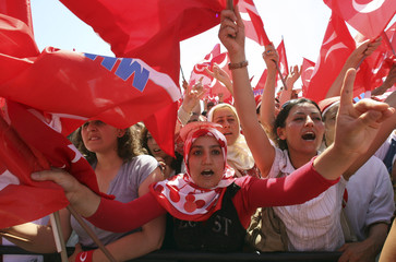Supporters of Nationalist Movement Party wave party flags at an election rally in Istanbul