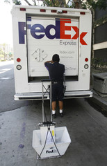 Federal Express courier readies packages for delivery in Los Angeles